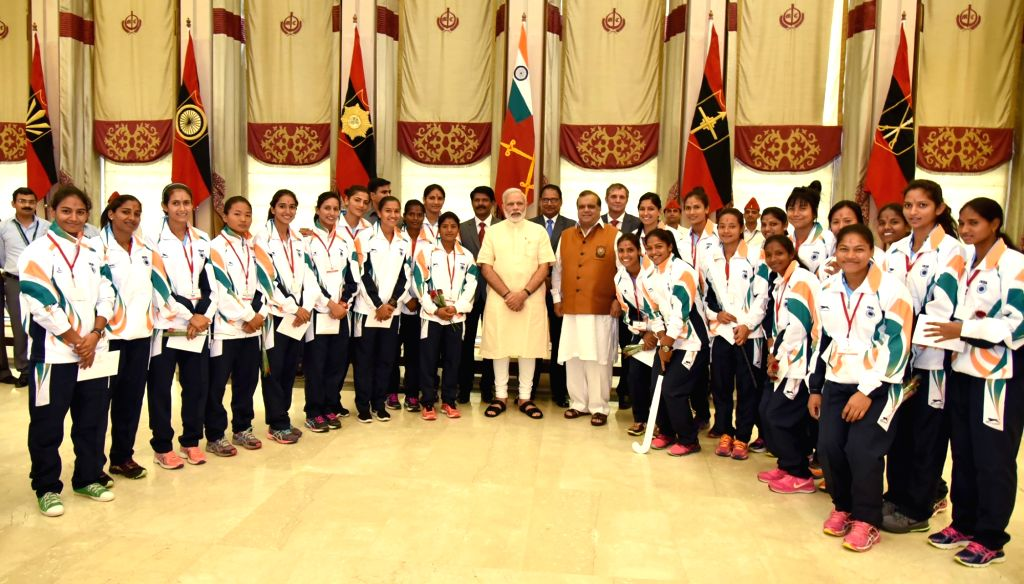 Prime Minister Narendra Modi in a group photograph with the athletes who will be representing India at forthcoming Rio Olympic Games, in New Delhi on July 4, 2016. - Narendra Modi