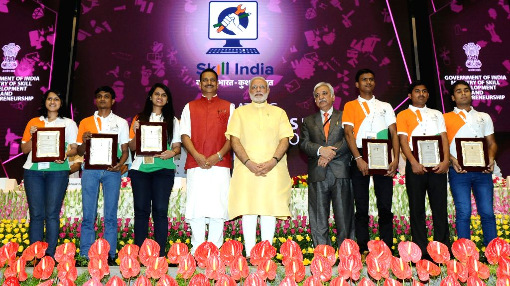 Prime Minister Narendra Modi in group photo with the Skill trainees, who won international awards in different fields of Skill Development, at the launch of the Skill India Mission, on the ... - Narendra Modi and Sunil Arora