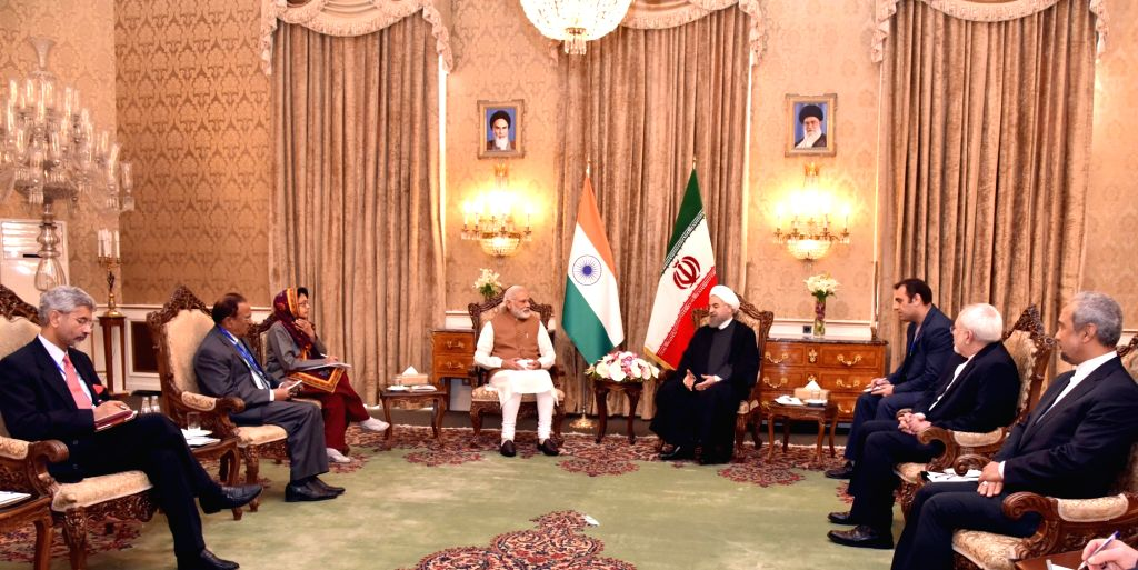Prime Minister Narendra Modi in restricted tete-a-tete with the President of Iran, Hassan Rouhani, in Jomhouri Building, at Saadabad Palace, in Tehran on May 23, 2016. - Narendra Modi