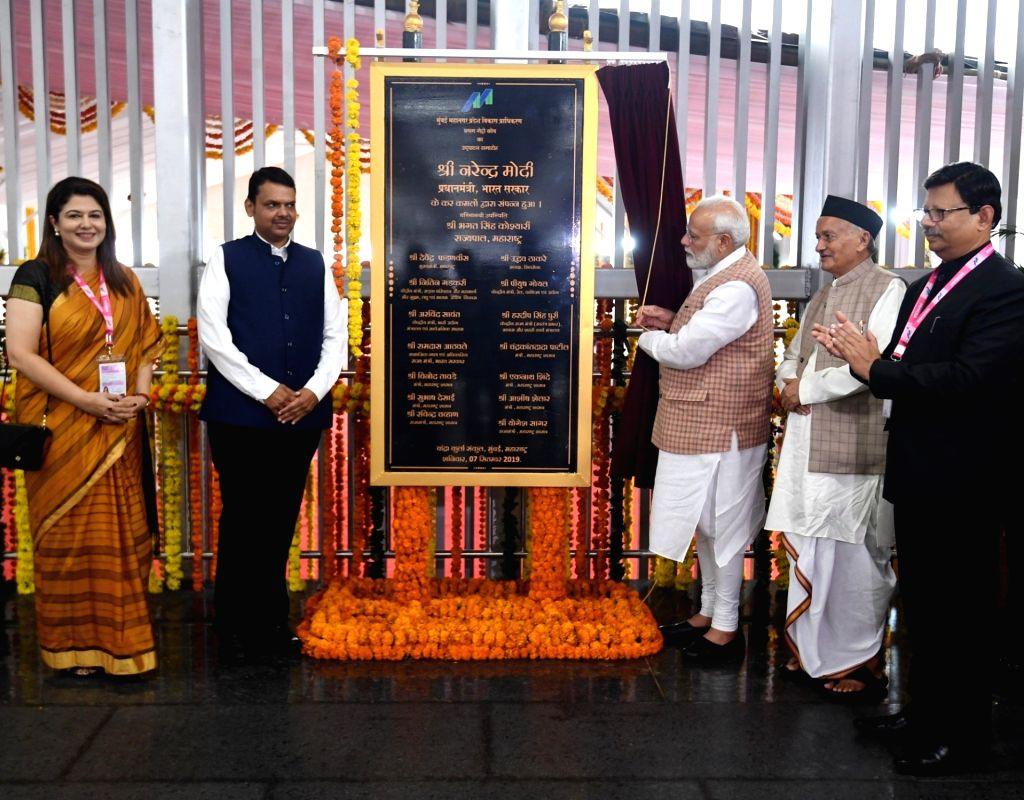 Prime Minister Narendra Modi inaugurates a state-of-the-art metro coach, the first metro coach under Make in India, in Mumbai on Sep 7, 2019. Also seen Maharashtra Governor Bhagat Singh ... - Narendra Modi and Bhagat Singh Koshyari