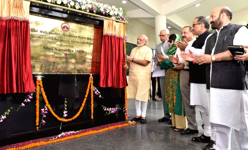 Prime Minister Narendra Modi inaugurates Shri Mata Vaishno Devi Narayana Superspeciality Hospital, at Katra, in Jammu and Kashmir on April 19, 2016. Also seen Jammu and Kashmir Governor NN ... - Narendra Modi, Mehbooba Mufti, Nirmal Kumar Singh and Jitendra Singh