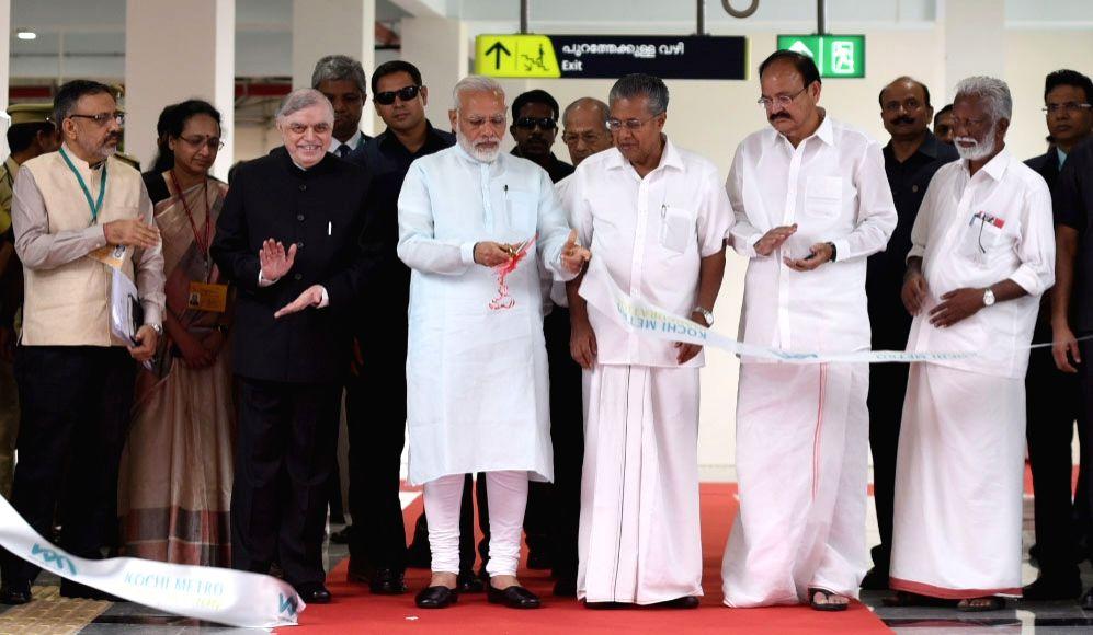 Prime Minister Narendra Modi inaugurates the Kochi Metro, in Kerala on June 17, 2017. The Governor of Kerala, Justice (Retd.) P. Sathasivam, the Union Minister for Urban Development, Housing ... - Narendra Modi and M. Venkaiah Naidu
