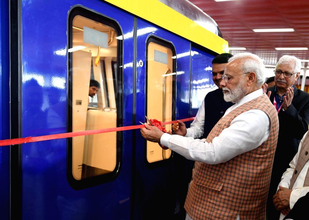 Prime Minister Narendra Modi inaugurates the Metro Coach Exhibition in Mumbai on Sep 7, 2019. Also seen Maharashtra Chief Minister Devendra Fadnavis. - Narendra Modi