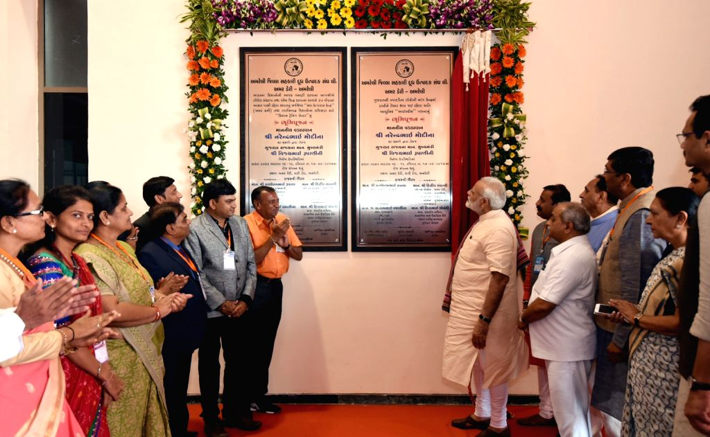 Prime Minister Narendra Modi inaugurates the new plants of Amar Dairy in Amreli, Gujarat on Sept 17, 2017. Also seen Gujarat Chief Minister Vijay Rupani, Deputy Chief Minister Nitinbhai Patel ... - Narendra Modi and Nitinbhai Patel