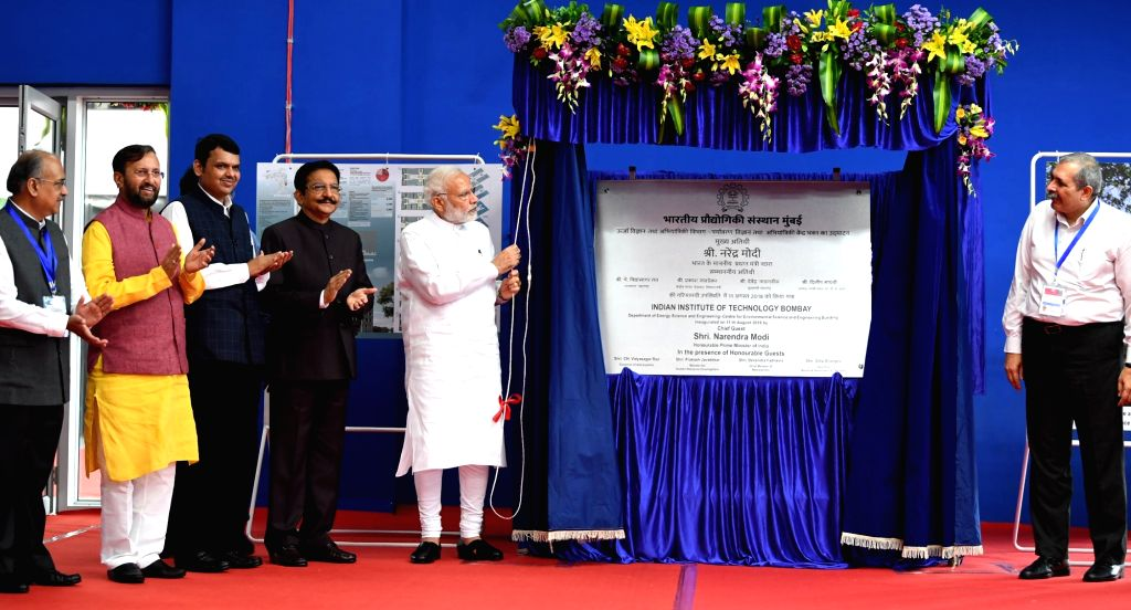 Prime Minister Narendra Modi inaugurates the new building of the Department of Energy Science & Engineering and Centre for Environmental Science and Engineering at IIT Bombay, in Mumbai ... - Narendra Modi and C. Vidyasagar Rao