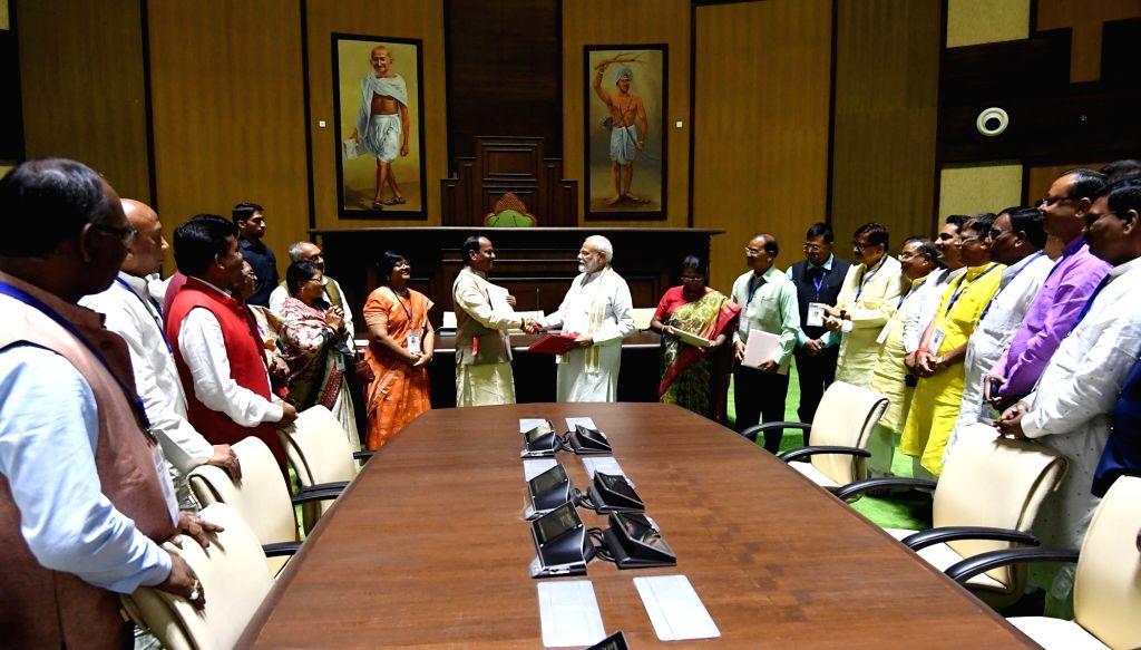 Prime Minister Narendra Modi inaugurates the new Jharkhand Vidhan Sabha building, in Ranchi on Sep 12, 2019. Also seen Jharkhand Governor Draupadi Murmu and Chief Minister Raghubar Das. - Narendra Modi