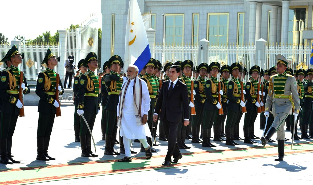 Prime Minister Narendra Modi inspecting the Guard of Honour during the ceremonial welcome, at Independence Square, in Oguzkhan Palace, Ashgabat, Turkmenistan on July 11, 2015. The President ... - Narendra Modi