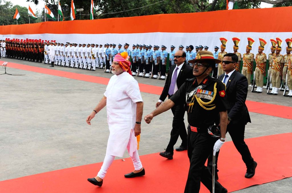 Prime Minister Narendra Modi inspecting the Guard of Honour at Red Fort, on the occasion of 70th Independence Day, in Delhi on Aug 15, 2016. - Narendra Modi