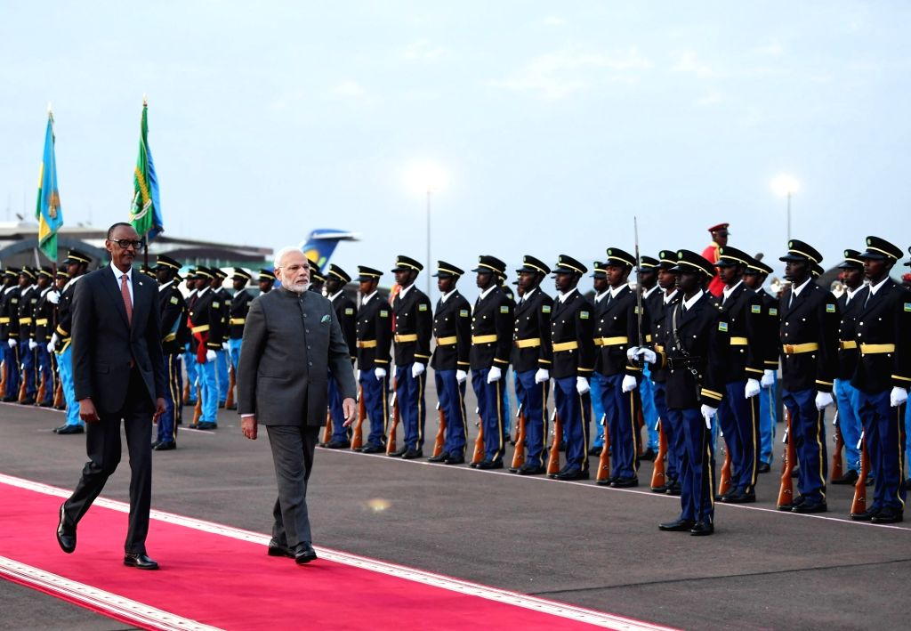 Prime Minister Narendra Modi inspects the Guard of Honour accompanied by Rwanda President Paul Kagame, on his arrival at Kigali International Airport in Rwanda on July 23, 2018. - Narendra Modi