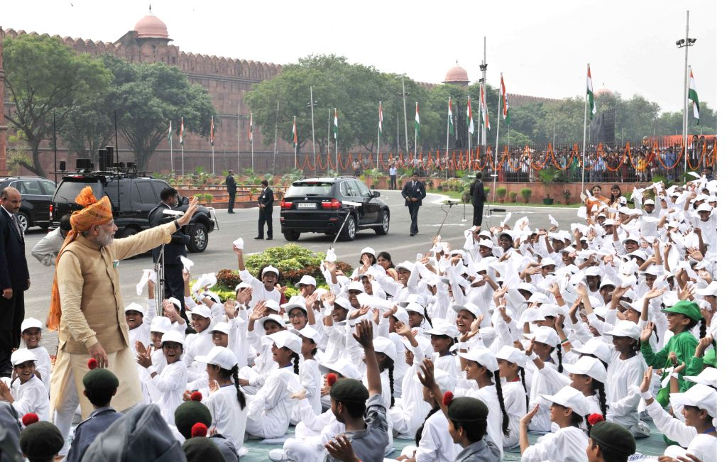 Prime Minister Narendra Modi interacting with the school children after addressing the Nation on the occasion of 69th Independence Day from the ramparts of Red Fort, in Delhi on August 15, ... - Narendra Modi
