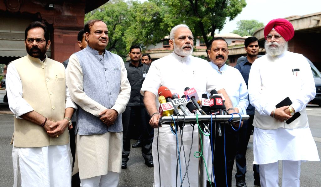 Prime Minister Narendra Modi interacting with the media at the start of Monsoon Session of Parliament, in New Delhi on July 18, 2016. The Union Minister for Chemicals and Fertilizers and ... - Narendra Modi, Affairs Ananth Kumar and Jitendra Singh