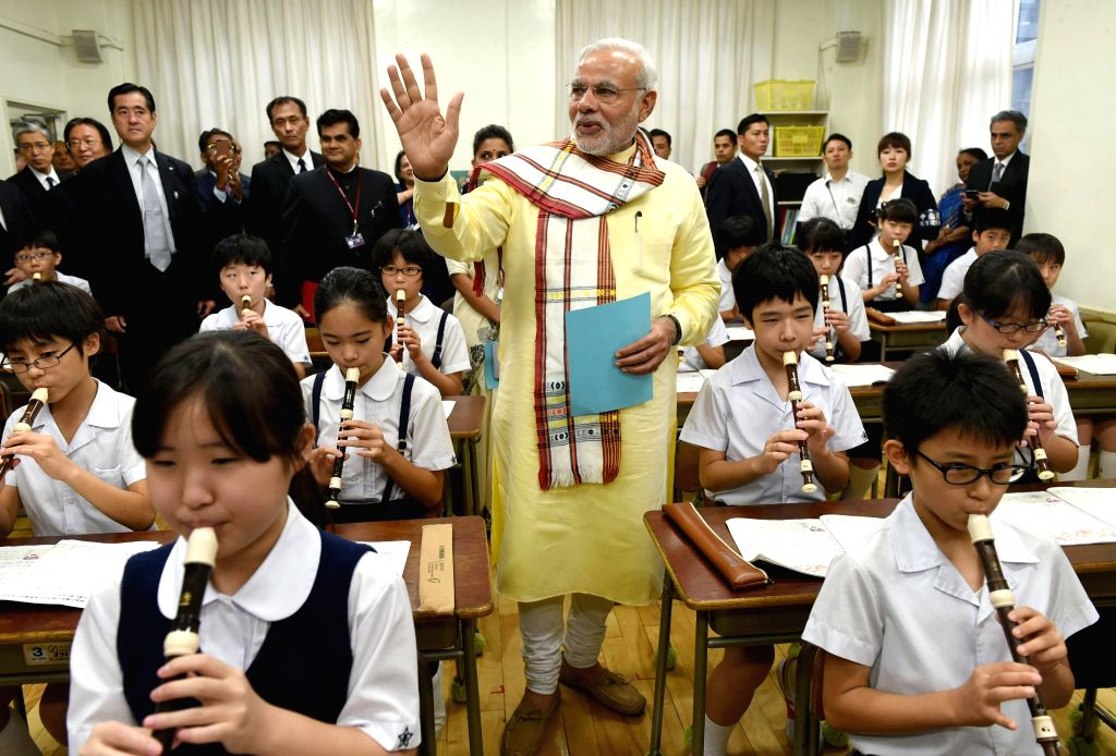 Prime Minister Narendra Modi interacts with children during his visit to Taimei Elementary School, in Tokyo, Japan on Sept 1, 2014. - Narendra Modi