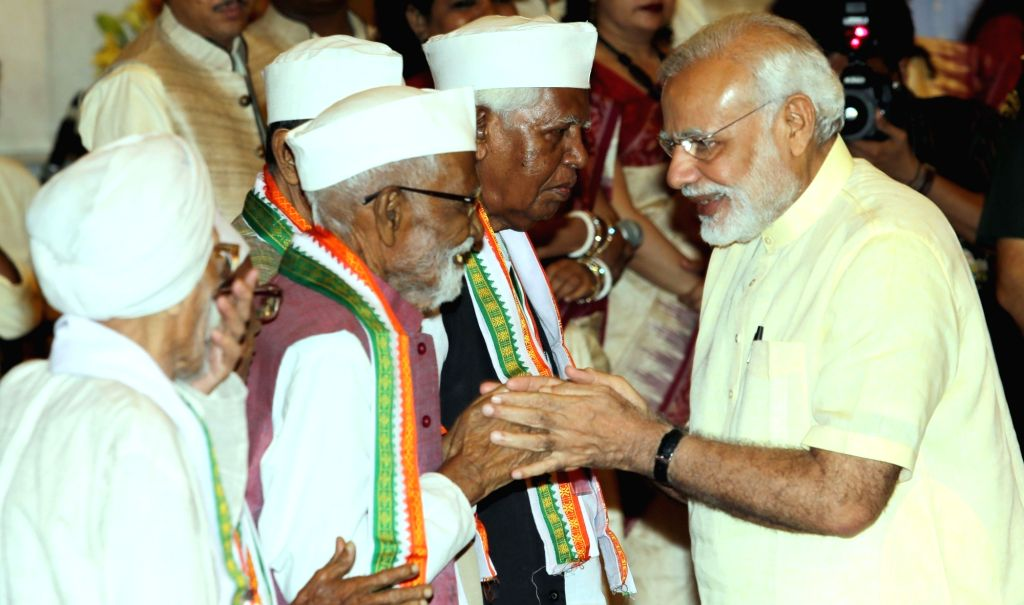 Prime Minister Narendra Modi interacts with freedom fighters during a reception hosted by him for Freedom Fighters at Rashtrapati Bhawan in New Delhi, on Aug 9, 2016. (Photo: IANS)​ - Narendra Modi