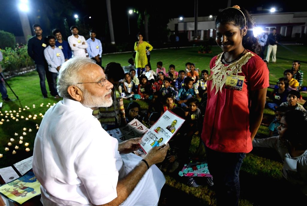 Prime Minister Narendra Modi interacts with children from underprivileged sections, in Varanasi, on Sept 17, 2018. - Narendra Modi
