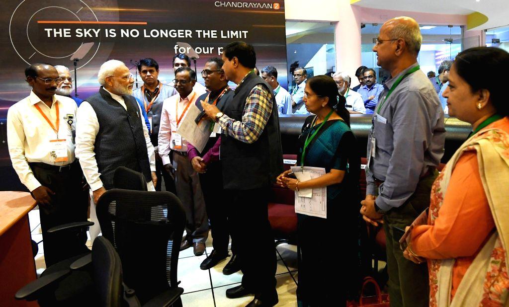 Prime Minister Narendra Modi interacts with scientists at the ISRO Headquarters in Bengaluru on Sep 7, 2019. - Narendra Modi