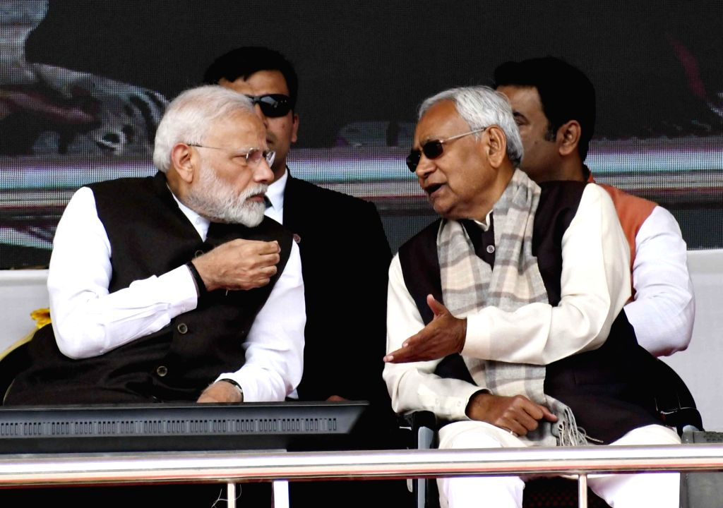 Prime Minister Narendra Modi interacts with Bihar Chief Minister Nitish Kumar during the inauguration of various development projects in Bihar's Barauni, on Feb 17, 2019. - Narendra Modi and Nitish Kumar