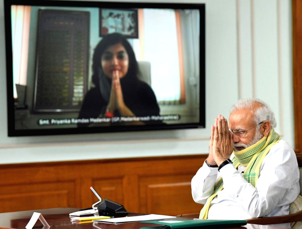 Prime Minister Narendra Modi interacts with the Sarpanchs from across the country on the occasion of the National Panchayati Raj Divas through video-conferencing during the extended ... - Narendra Modi and Narendra Singh Tomar