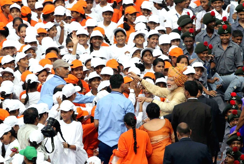 Prime Minister Narendra Modi interacts with the school children after addressing the Nation on the occasion of 69th Independence Day from the ramparts of Red Fort, in Delhi on Aug 15, ... - Narendra Modi