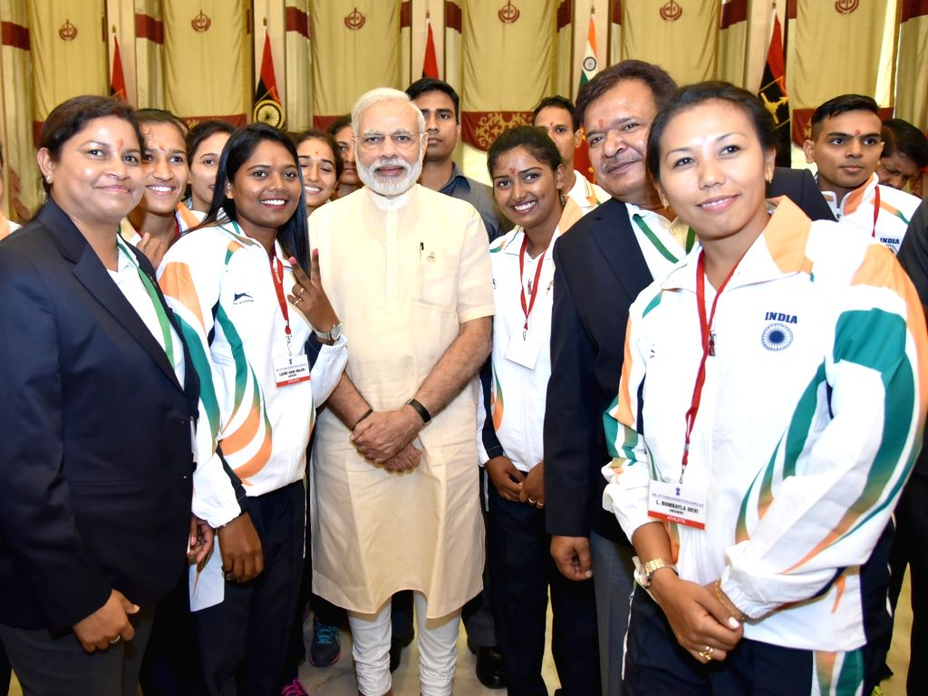 Prime Minister Narendra Modi interacts with the the athletes who will be representing India at forthcoming Rio Olympic Games, in New Delhi on July 4, 2016. - Narendra Modi