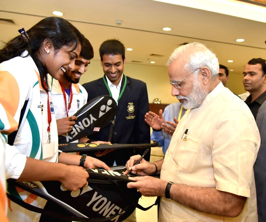 Prime Minister Narendra Modi interacts with the athletes who will be representing India at forthcoming Rio Olympic Games, in New Delhi on July 4, 2016. - Narendra Modi