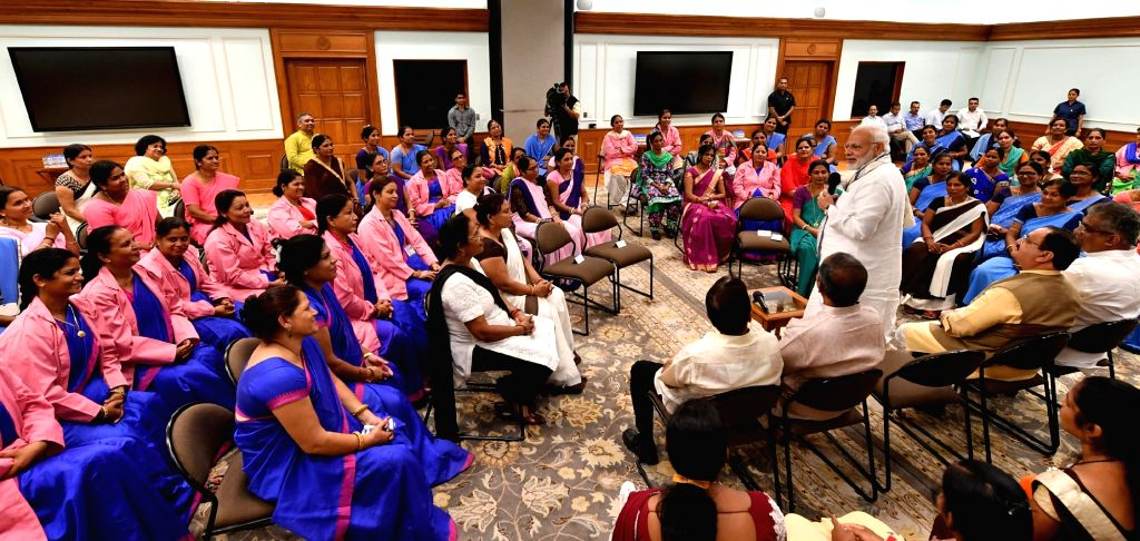 Prime Minister Narendra Modi interacts with the Accredited Social Health Activist (ASHA) representatives from across the country, in New Delhi on Sept 20, 2018. - Narendra Modi