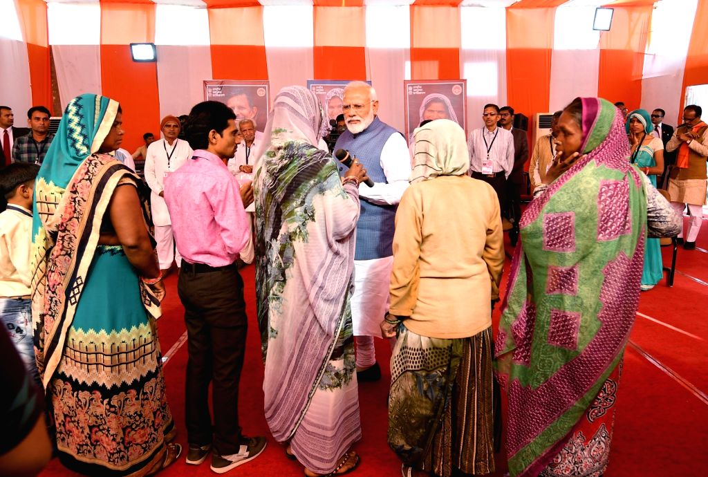 Prime Minister Narendra Modi interacts with the beneficiaries of Ayushman Bharat Yojna in Dhar, Madhya Pradesh on March 5, 2019. - Narendra Modi