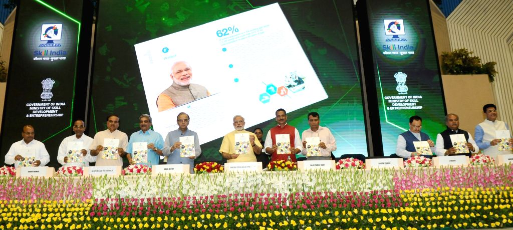 Prime Minister Narendra Modi launch the logo of the Skill India Mission, on the occasion of the World Youth Skills Day, in New Delhi on July 15, 2015. Also seen The Union Ministers Arun ... - Narendra Modi, Arun Jaitley, Manohar Parrikar, Suresh Prabhu, Anant Geete, J., Ananth Kumar and Narendra Singh Tomar