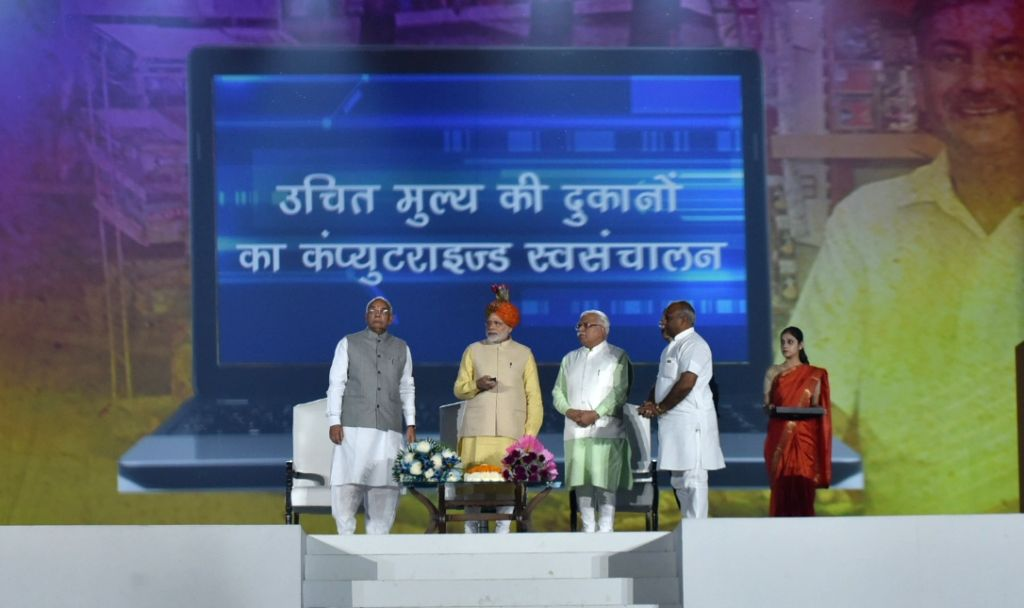 Prime Minister Narendra Modi launches the Automation of Fair Price Shops (FPS) in Haryana during Haryana Swarna Jayanti celebrations in Gurugram on Nov 1, 2016. Also seen Haryana Governor ... - Narendra Modi, Kaptan Singh Solanki and Manohar Lal Khattar