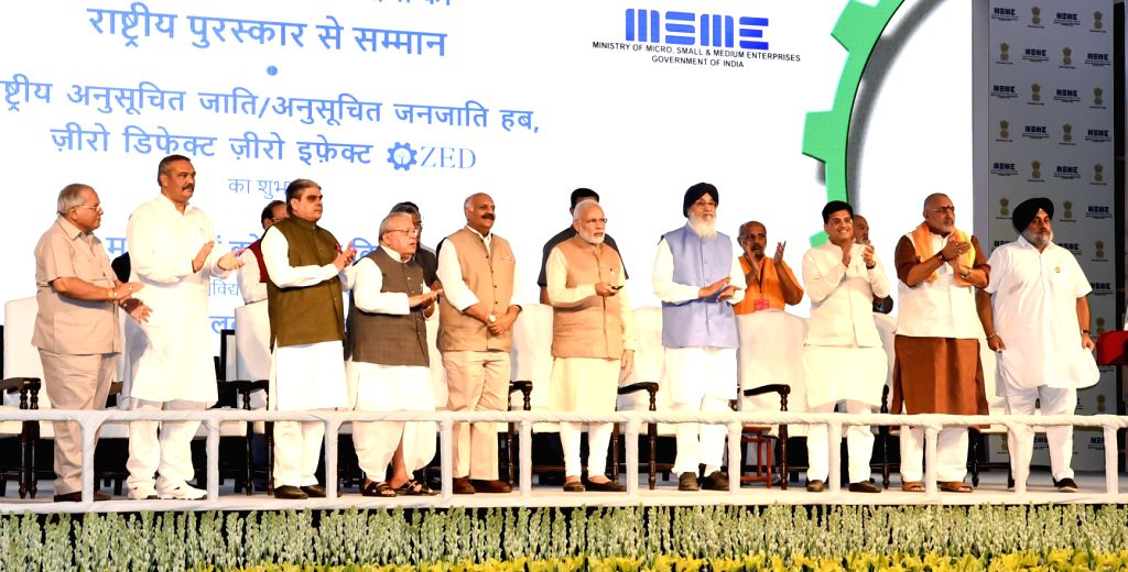 Prime Minister Narendra Modi launches the SC/ST Hub and Zero Defect Zero Effect Scheme at the National MSME Awards ceremony at Punjab Agricultural University (PAU) in Ludhiana on Oct 18, ... - Narendra Modi and Parkash Singh Badal