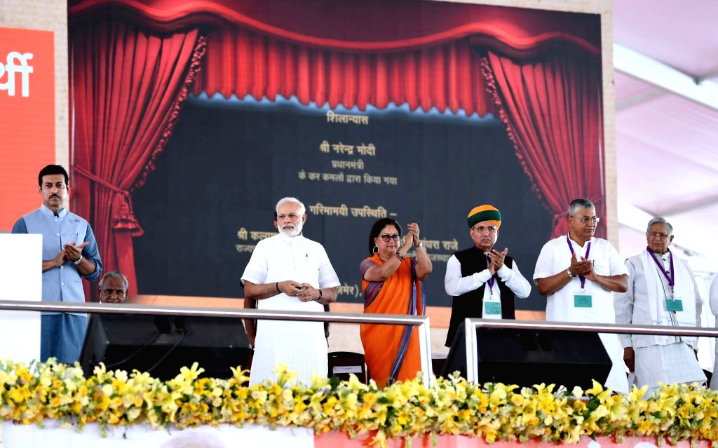 Prime Minister Narendra Modi lays the foundation stone for various urban infrastructure projects in Rajasthan along with Rajasthan Chief Minister Vasundhara Raje and Union Ministers ... - Narendra Modi, Rajyavardhan Singh Rathore and Arjun Ram Meghwal