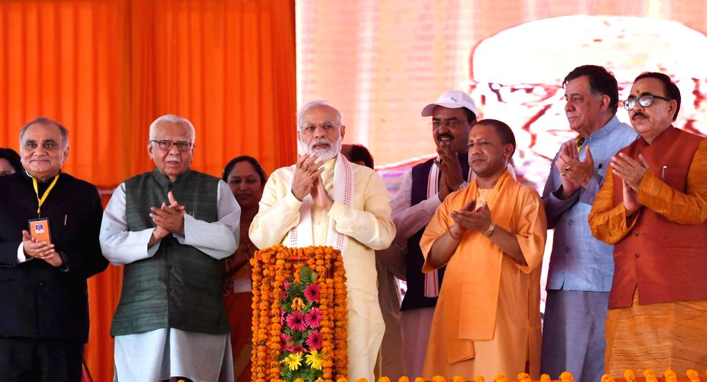 Prime Minister Narendra Modi lays the foundation stone laying ceremony of Poorvanchal Expressway in Azamgarh, Uttar Pradesh on July 14, 2018. Also seen Uttar Pradesh Governor Ram Naik, ... - Narendra Modi