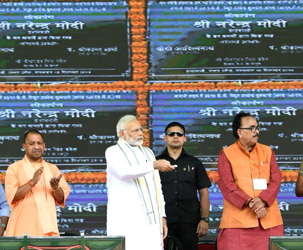 Prime Minister Narendra Modi lays the foundation stone for various development projects along with Uttar Pradesh Chief Minister Yogi Adityanath and UP BJP chief Mahendra Nath Pandey, in ... - Narendra Modi and Mahendra Nath Pandey