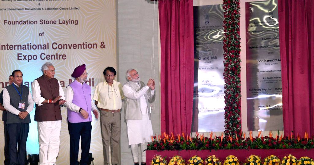 Prime Minister Narendra Modi lays the foundation stone for the India International Convention and Expo Centre along with Union Commerce and Industry and Civil Aviation Minister Suresh ... - Narendra Modi, Suresh Prabhakar Prabhu and R. Chaudhary
