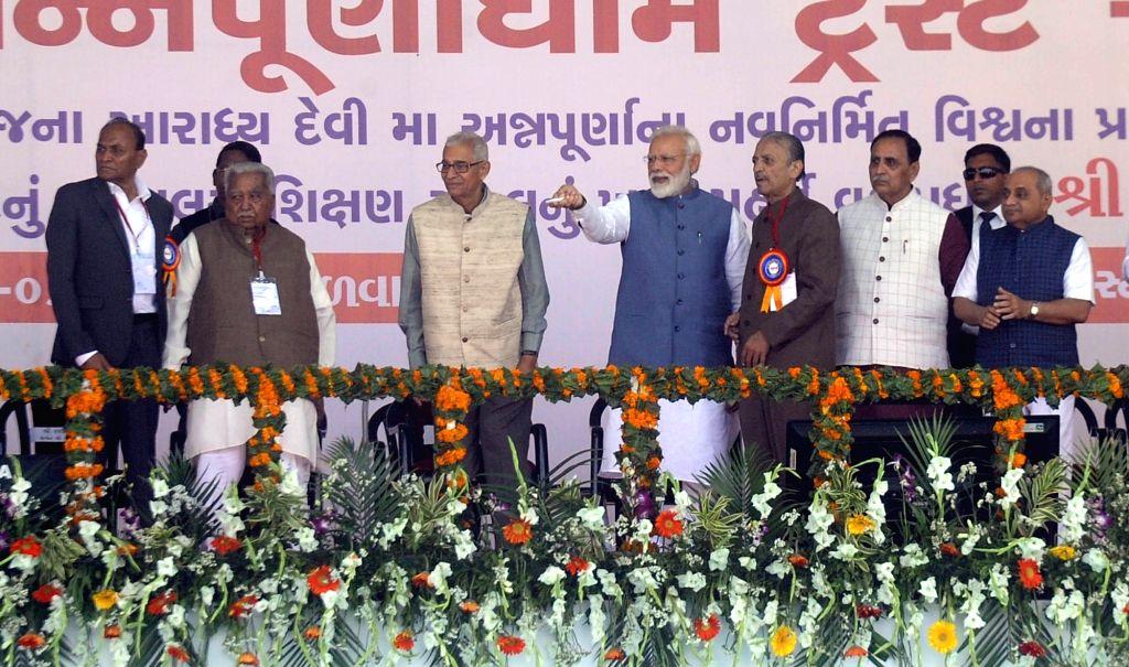 Prime Minister Narendra Modi lays the foundation stone of Shikshan Bhavan and Vidhyarthi Bhavan at Annapurna Dham Trust, in Adalaj, Gujarat on March 5, 2019. Also seen Gujarat Governor O.P. ... - Narendra Modi, P. Kohli and Nitinbhai Patel