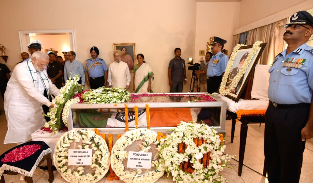 Prime Minister Narendra Modi lays wreath on the mortal remains of Marshal of Air Force Arjan Singh at his 7A, Kautilya Marg residence in New Delhi on Sept 17, 2017. Marshal of the Air ... - Narendra Modi and Force Arjan Singh