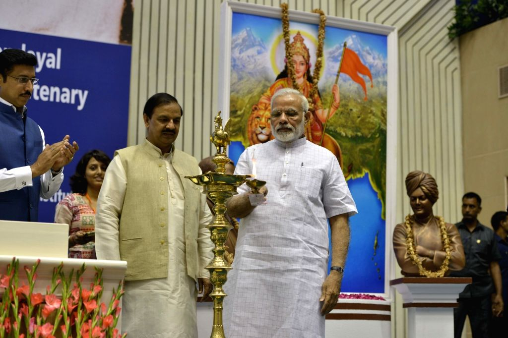 Prime Minister Narendra Modi lights the lamp during convention of student leaders on the theme of 'Young India, New India' and 125th anniversary of Swami Vivekanand's Chicago address in ... - Narendra Modi, Mahesh Sharma and Rajyavardhan Singh Rathore