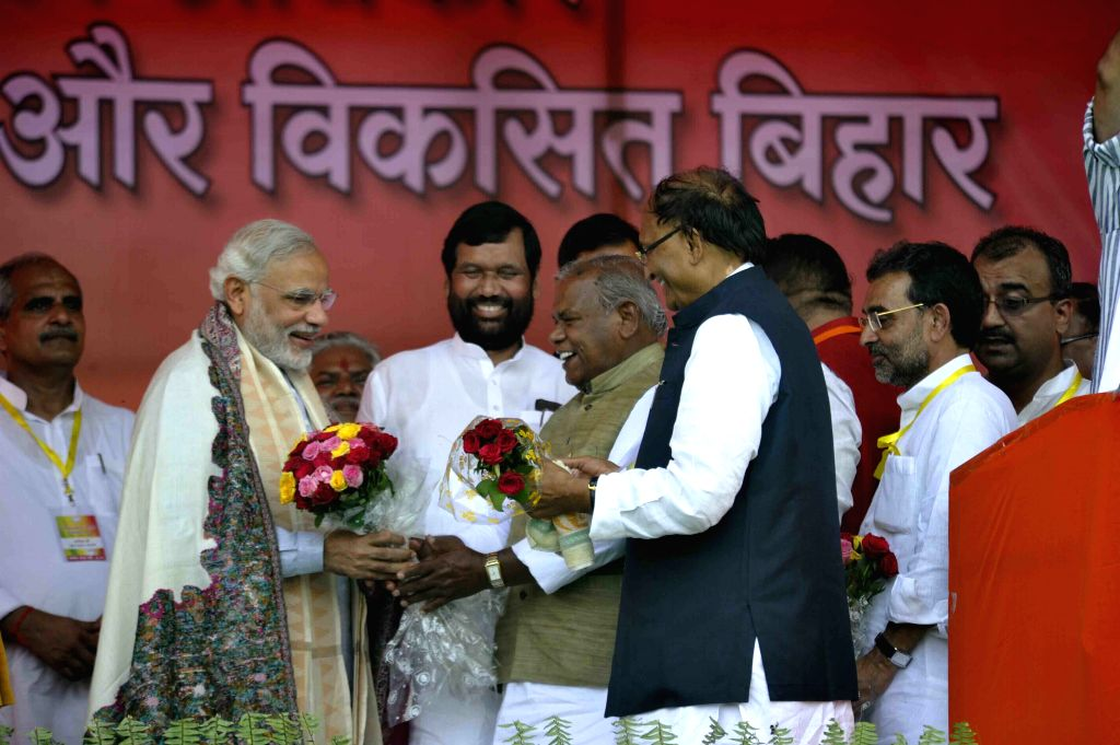 Prime Minister Narendra Modi, LJP chief and Union Minister for Consumer Affairs, Food and Public Distribution Ramvilas Paswan, Union Minister Upendra Kushwaha and HAM leader Jitan Ram Manjhi ... - Narendra Modi