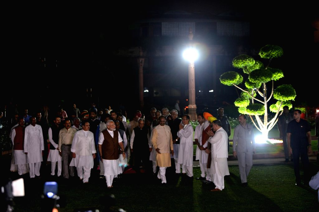 Prime Minister Narendra Modi, Lok Sabha Speaker Om Birla and Union Ministers during the inauguration of the dynamic facade lighting of Parliament House in New Delhi on Aug 13, 2019. - Narendra Modi