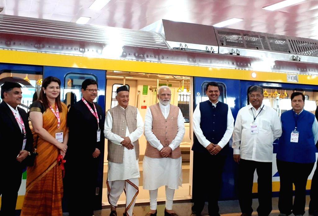 Prime Minister Narendra Modi, Maharashtra Governor Bhagat Singh Koshyari and Chief Minister Devendra Fadnavis at the inauguration of a state-of-the-art metro coach, the first metro coach ... - Narendra Modi and Bhagat Singh Koshyari