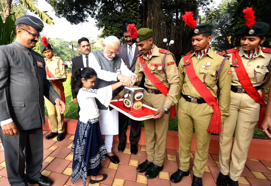 Prime Minister Narendra Modi makes a contribution for the welfare of Armed Forces, on the occasion of the Armed Forces Flag Day, in Pune on Dec 7, 2019. - Narendra Modi