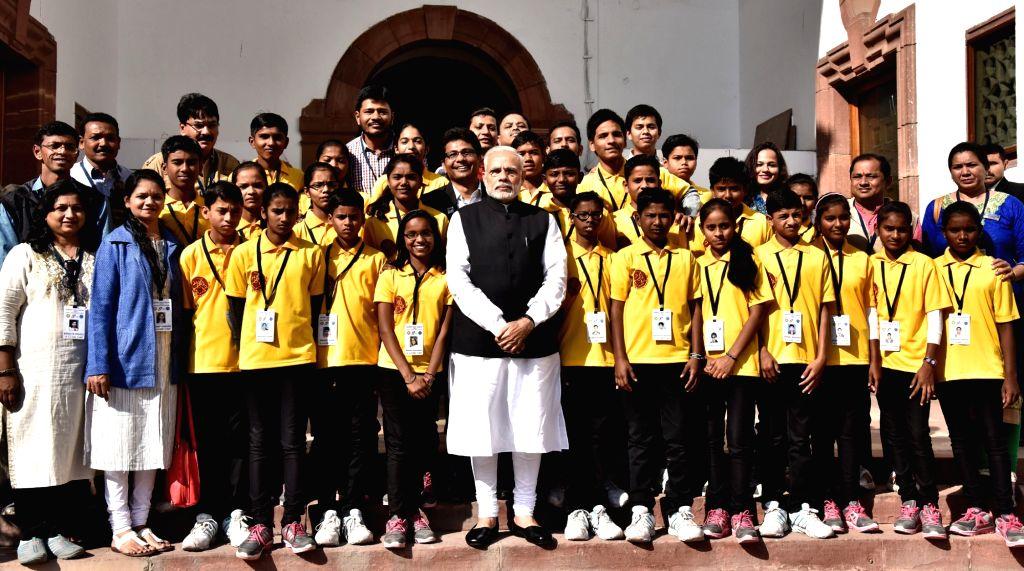Prime Minister Narendra Modi meets a group of underprivileged students from Wardha, Maharashtra; in New Delhi on Nov 28, 2016. - Narendra Modi