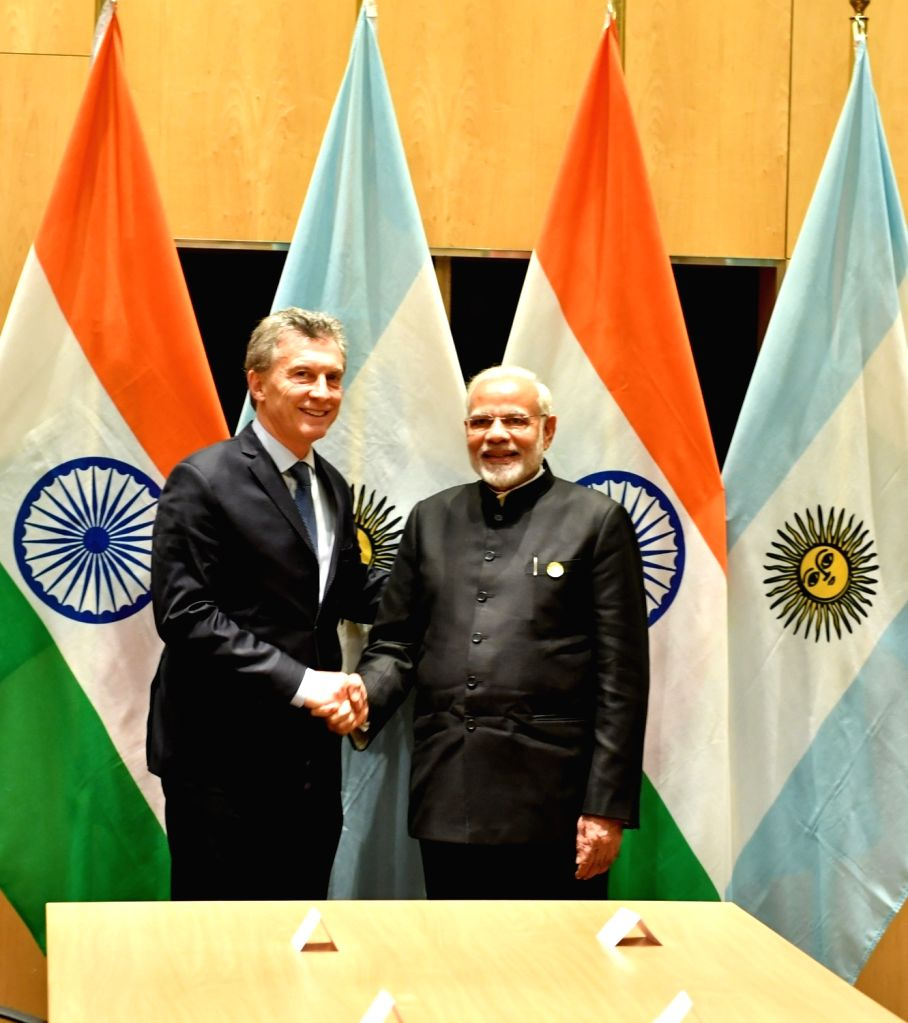 Prime Minister Narendra Modi meets Argentina President Mauricio Macri during the 10th BRICS Summit in Johannesburg, South Africa, on July 27, 2018. - Narendra Modi