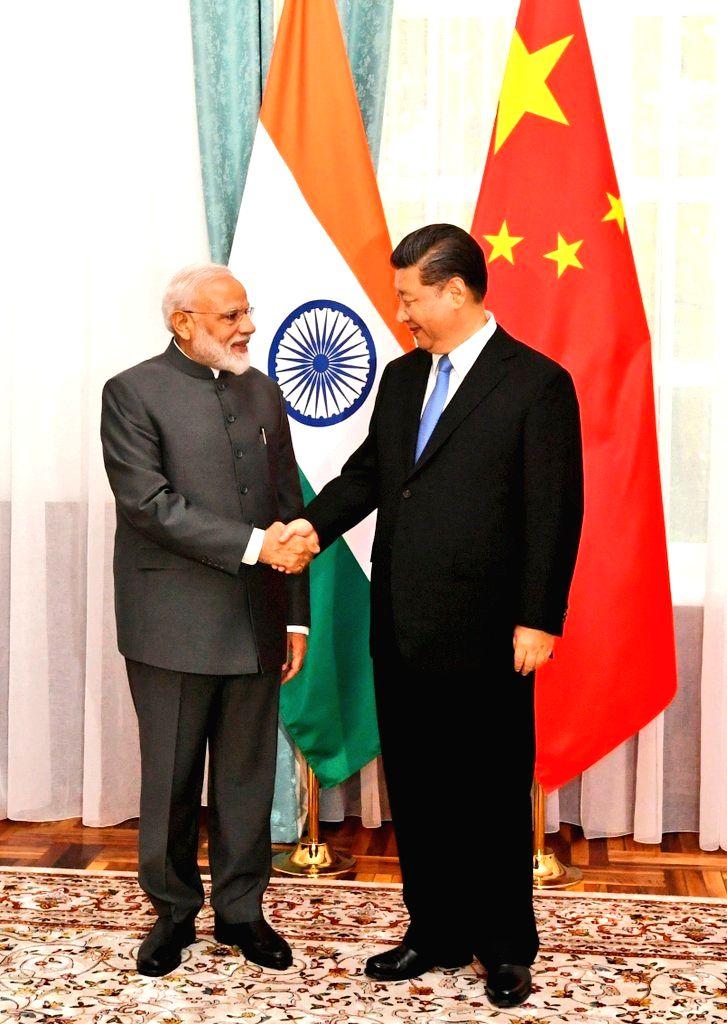 Prime Minister Narendra Modi meets Chinese President Xi Jinping in Bishkek, Kyrgyzstan on June 13, 2019. - Narendra Modi