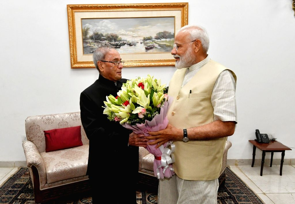 Prime Minister Narendra Modi meets Former President Pranab Mukherjee, in New Delhi on May 28, 2019. - Narendra Modi and Pranab Mukherjee