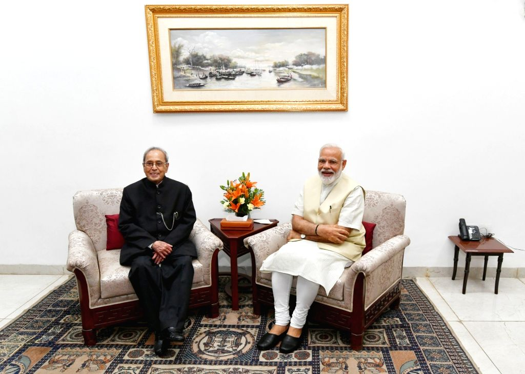 Prime Minister Narendra Modi meets Former President Pranab Mukherjee at his residence, in New Delhi on May 28, 2019. - Narendra Modi and Pranab Mukherjee