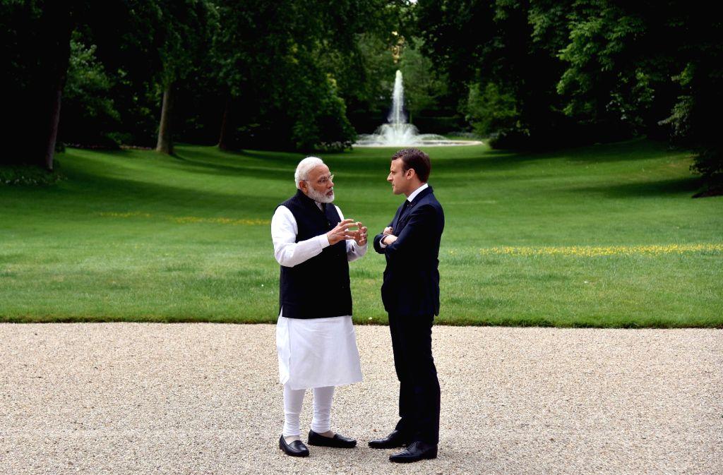 Prime Minister Narendra Modi meets France President Emmanuel Macron at Elysee Palace in Paris on June 3, 2017. - Narendra Modi