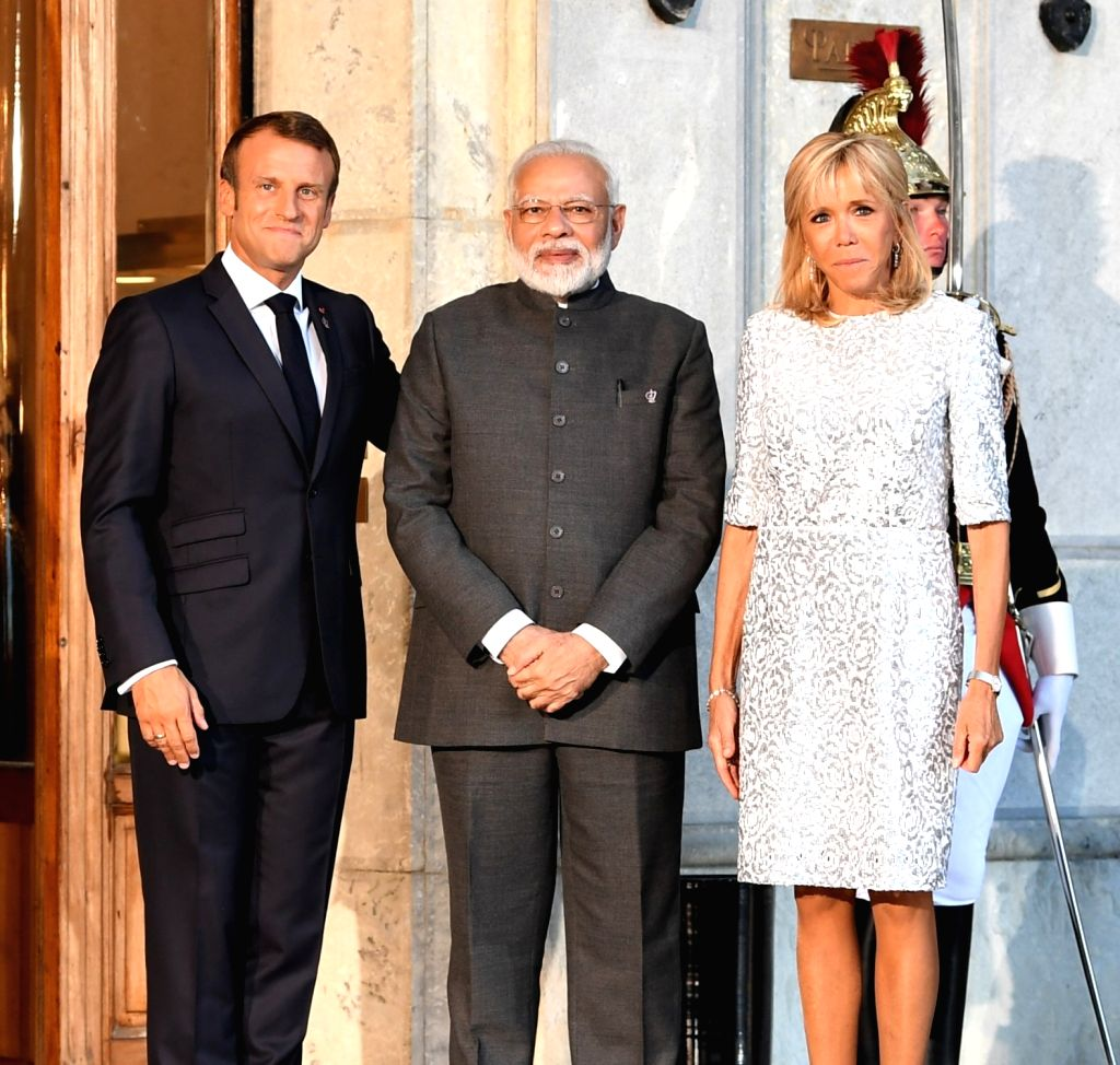 Prime Minister Narendra Modi meets French President Emmanuel Macron and his wife Brigitte Macron at the G7 Summit in Biarritz, France on Aug 25, 2019. - Narendra Modi