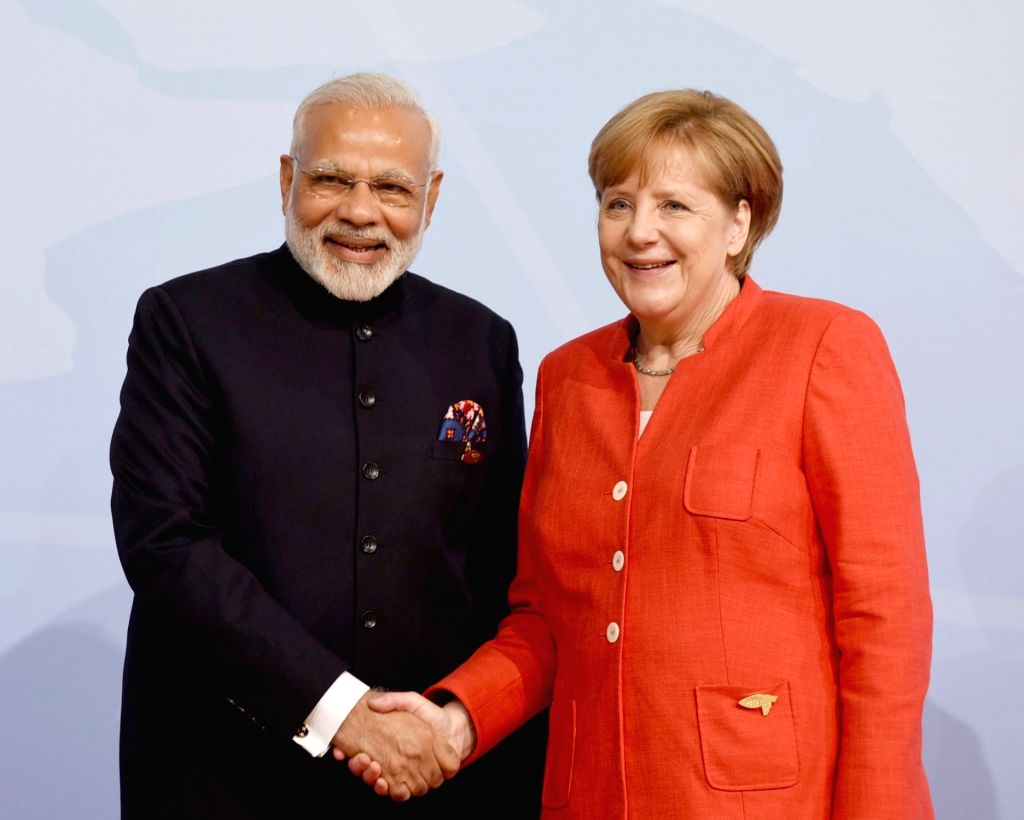 Prime Minister Narendra Modi meets German Chancellor Dr. Angela Merkel on the sidelines of the 12th G-20 Summit in Hamburg, Germany on July 7, 2017. - Narendra Modi