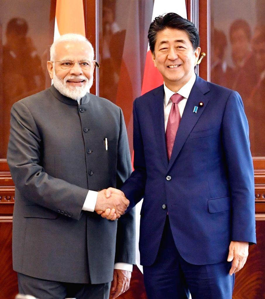 Prime Minister Narendra Modi meets Japan Prime Minister Shinzo Abe, on the sidelines of 5th Eastern Economic Forum (EEF), at Vladivostok, in Russia on Sep 5, 2019. - Narendra Modi