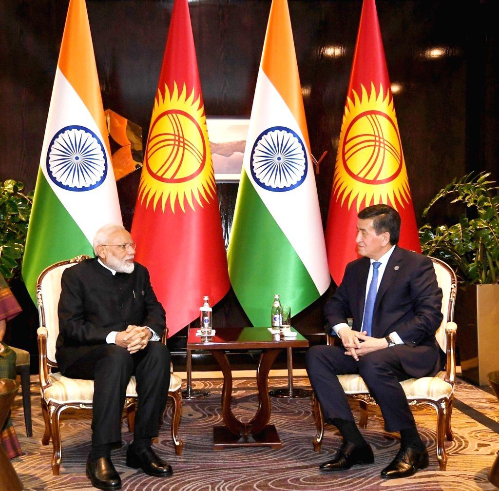 Prime Minister Narendra Modi meets Kyrgyzstan President Sooronbay Jeenbekov, in Bishkek, Kyrgyzstan on June 14, 2019. - Narendra Modi